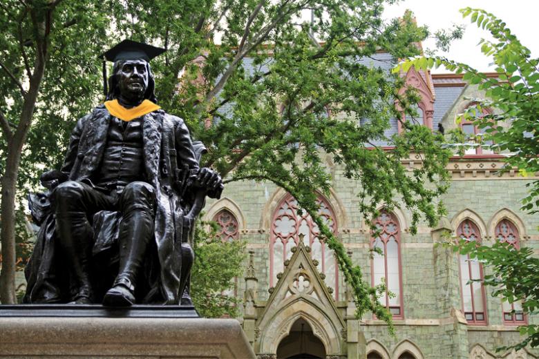Statue of Benjamin Franklin wearing graduation regalia