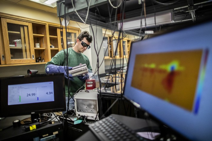 Ph.D. graduate Stephen Meloni in the physical chemistry lab of Jessica Anna