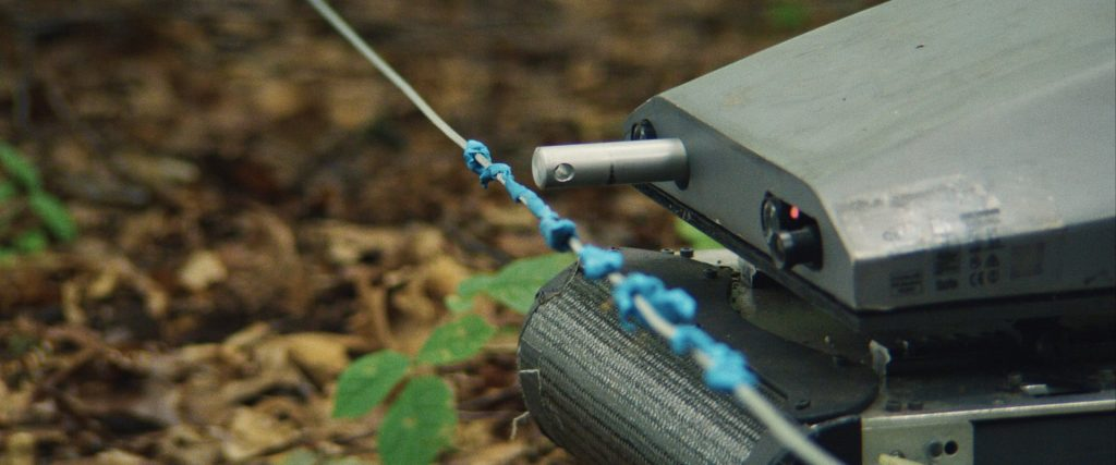 A detail shot from Lapsis, showing an automatic cabler detecting a wire trap.