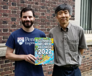Devin Carrol and Mark Yim pose with the 2022 edition of the Guinness World Records