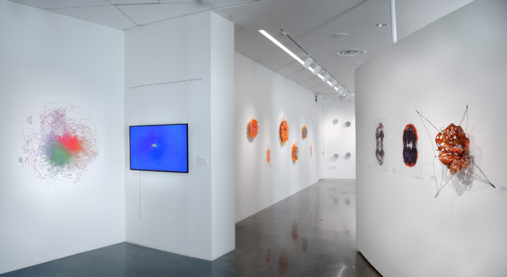 A gallery wall with data science themed art